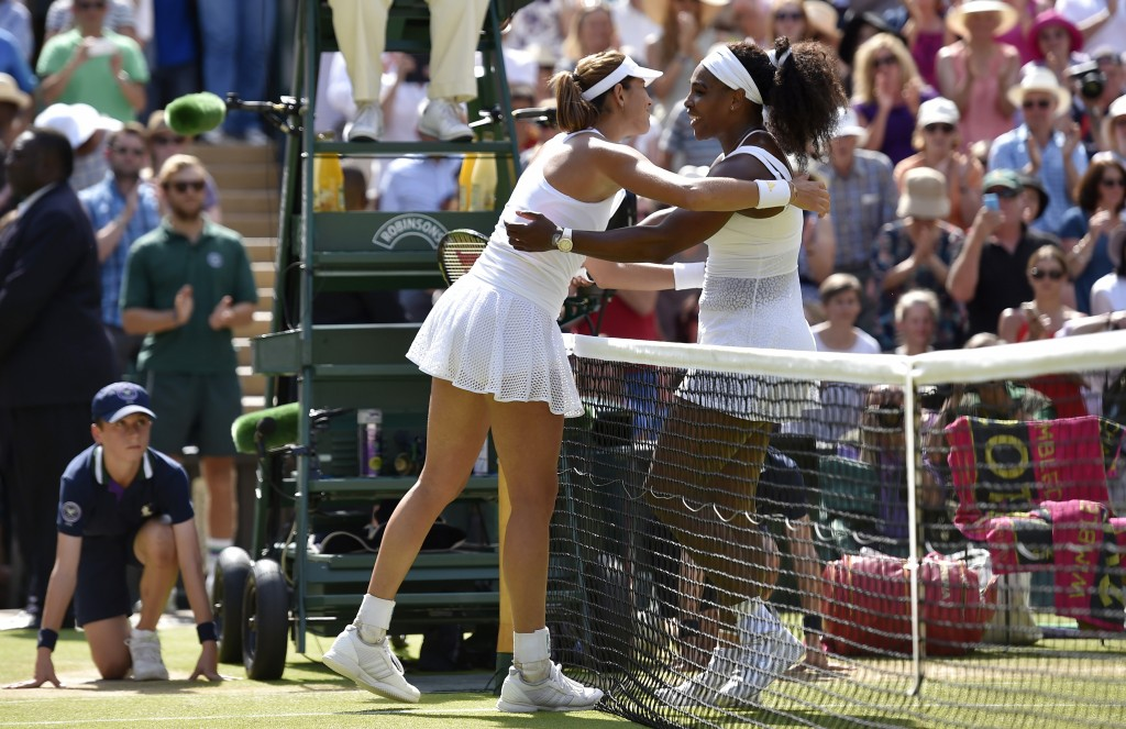 Serena Williams embraces Garbine Muguruza of Spain after winning their Women's Final match at the Wimbledon Tennis Championships in London, July 11, 2015.  Photo by Toby Melville/Reuters.