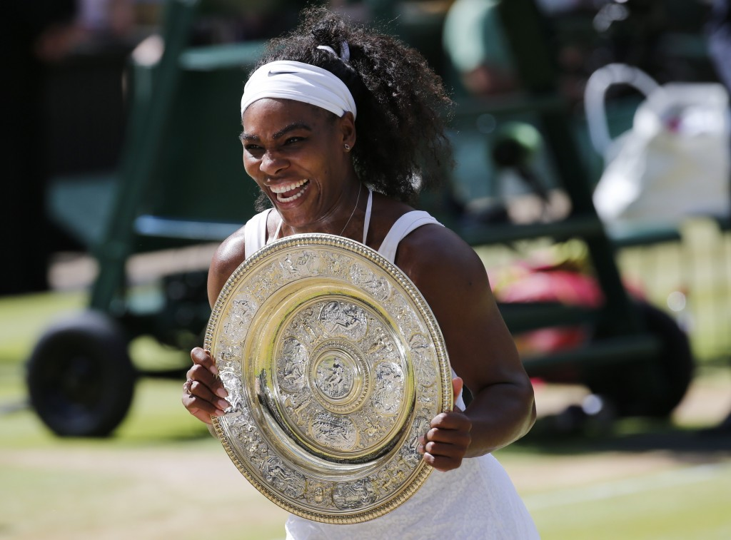 Serena Williams shows off the trophy after winning at Wimbledon on Saturday. Photo by Suzanne Plunkett/Reuters.