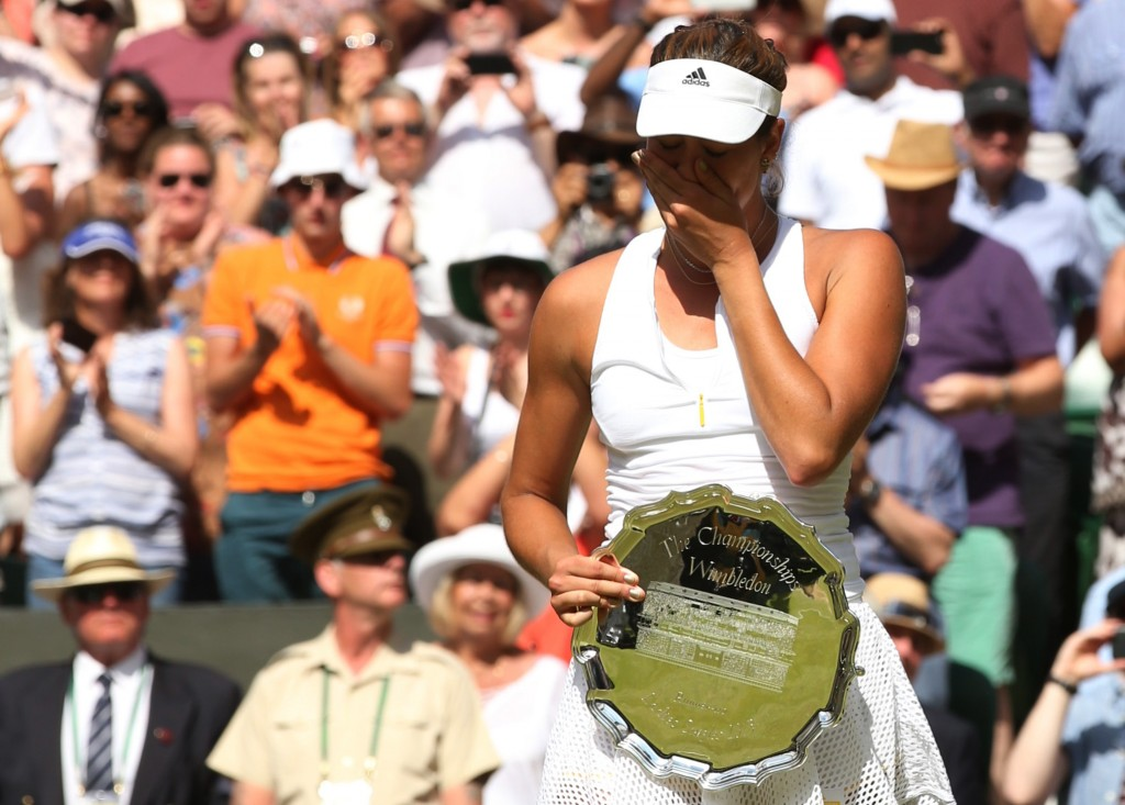 Garbine Muguruza of Spain reacts with her runner up trophy after losing her Women's Final match against Serena Williams at Wimbledon on Saturday.  Photo by Sean Dempsey/Reuters.