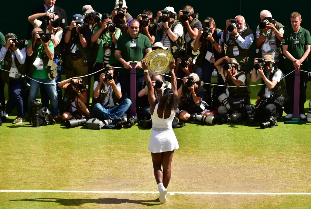 Serena Williams lifts the trophy after winningon July 11, 2015.  Photo by Dominic Lipinski/Reuters.