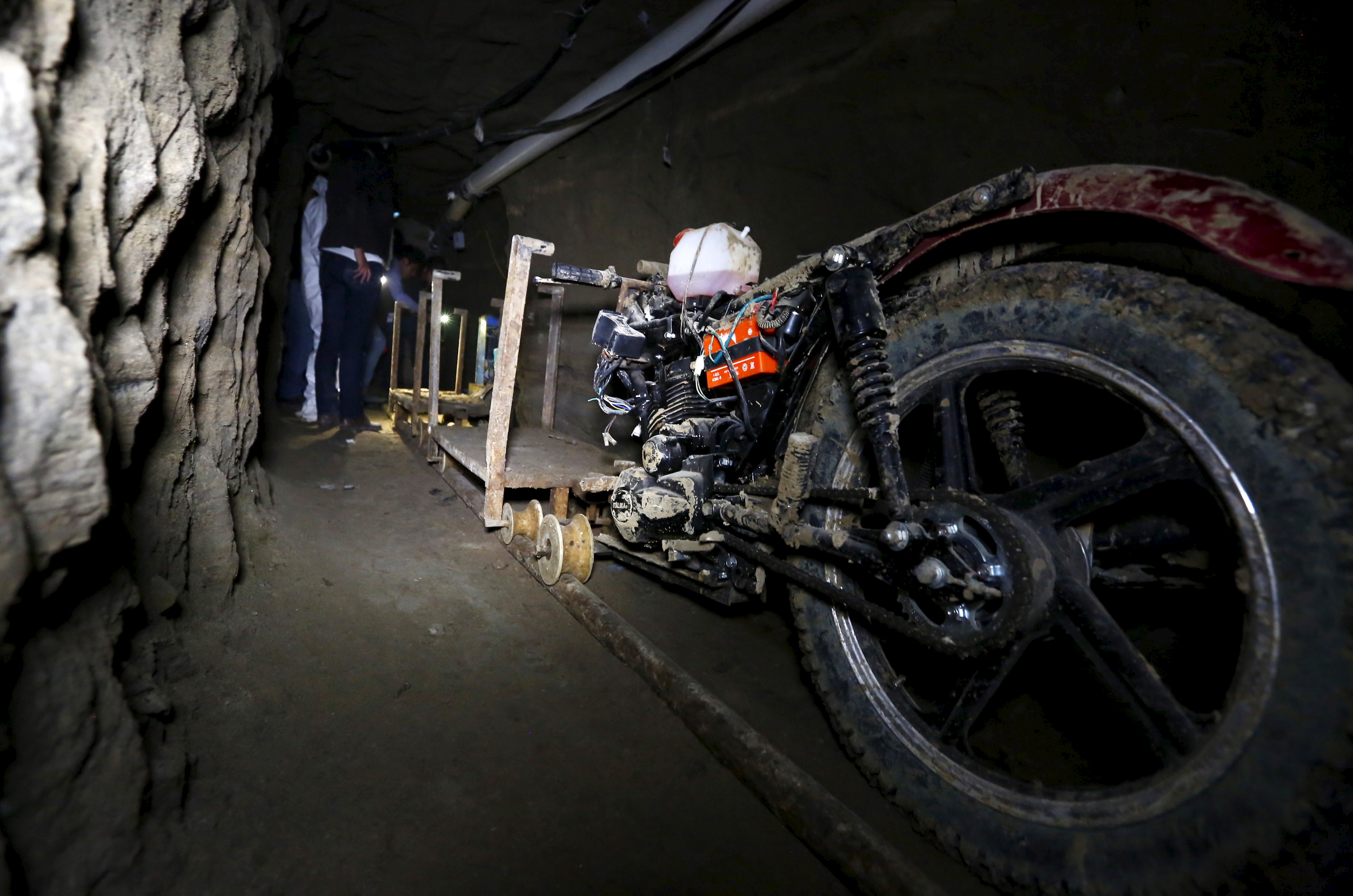 A motorcycle modified to run on rails is seen inside a tunnel connected to the Altiplano Federal Penitentiary and used by drug lord Joaquin 'El Chapo' Guzman to escape, in Almoloya de Juarez, on the outskirts of Mexico City, July 15, 2015. U.S. law enforcement officials met with agents of the Mexican attorney general's office this week to share information related to the escape from prison of Guzman and coordinate efforts to apprehend him, a Mexican government official said on Wednesday.  REUTERS/Edgard Garrido - RTX1KGHX