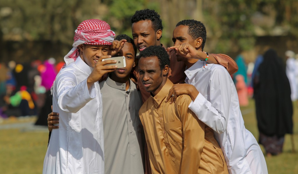 Muslim faithfuls take a selfie after attending in morning prayers to celebrate the first day of the Muslim holiday of Eid-al-Fitr at the Eastleigh High School in Eastleigh, a suburb in Nairobi on July 17, 2015. Photo by Boniface Mwangi/Reuters