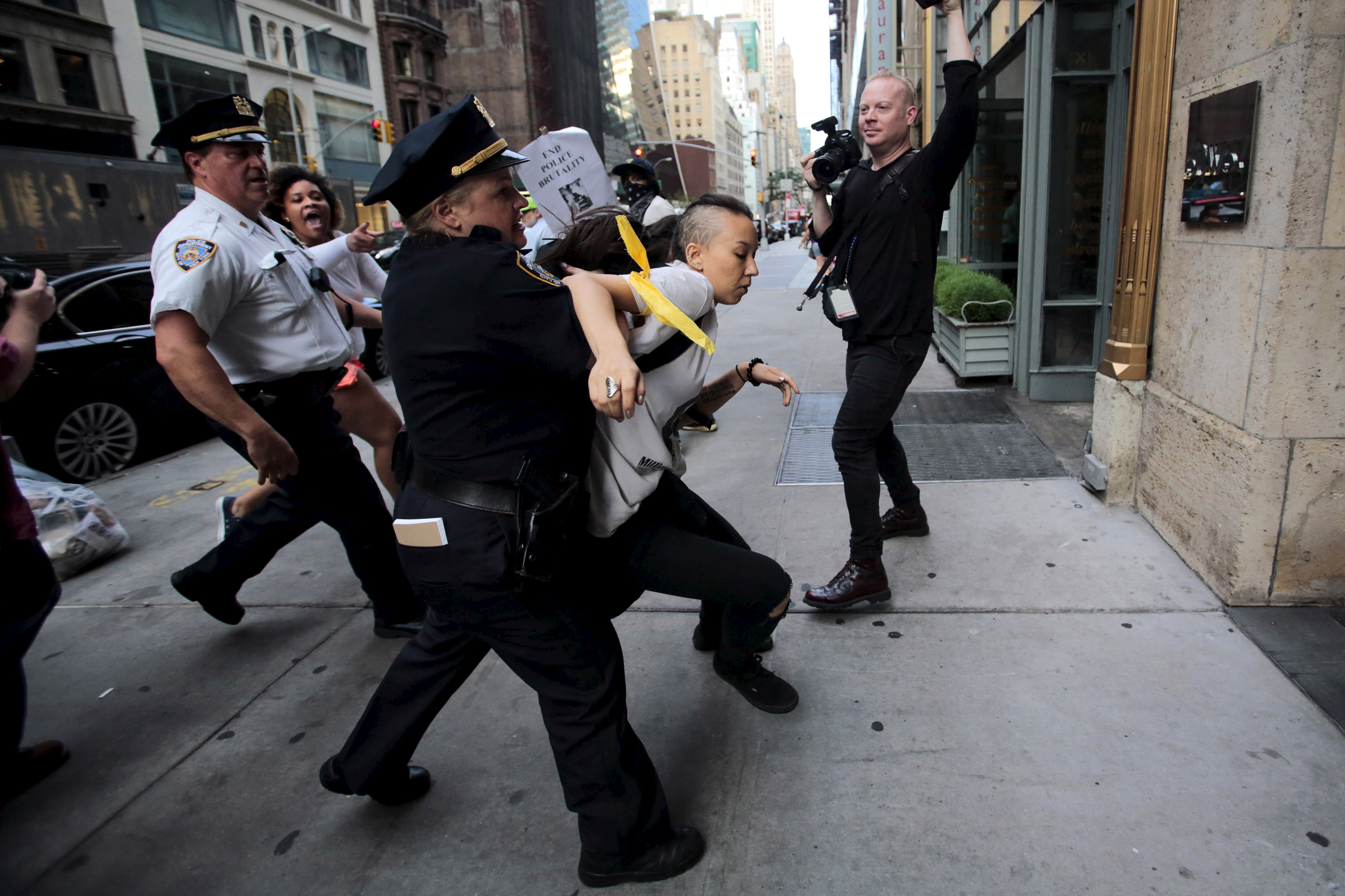 A protester is detained on July 17 by New York Police Department officers during a rally for Eric Garner who was killed one year ago by police in New York. Family and supporters on Friday marked the anniversary with rallies and vigils demanding police reforms and justice in the controversial case. Photo by Eduardo Munoz/Reuters