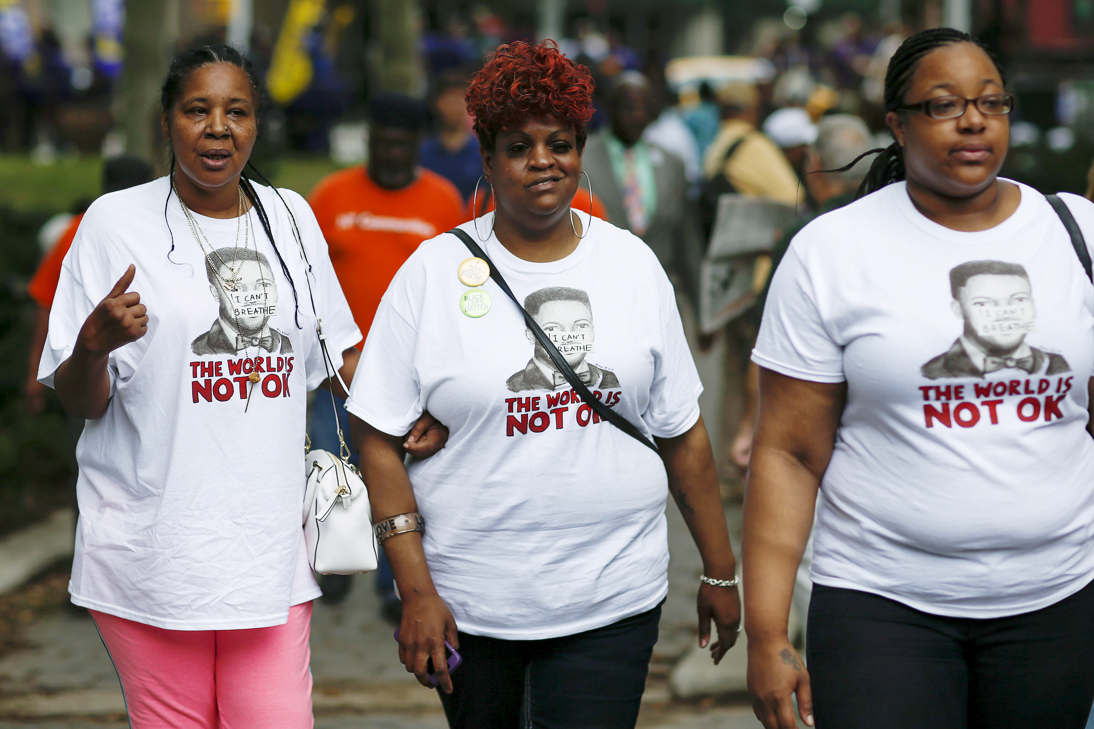 Esaw Garner, (L) widow of Eric Garner, and Emerald Snipes Garner (R), daughter of Eric Garner, arrive to attend a rally near a Brooklyn court in New York, July 18, 2015. Family and supporters marked the anniversary of the police killing of Eric Garner with rallies and vigils demanding police reforms and justice in the controversial case. Photo by Eduardo Munoz/Reuters