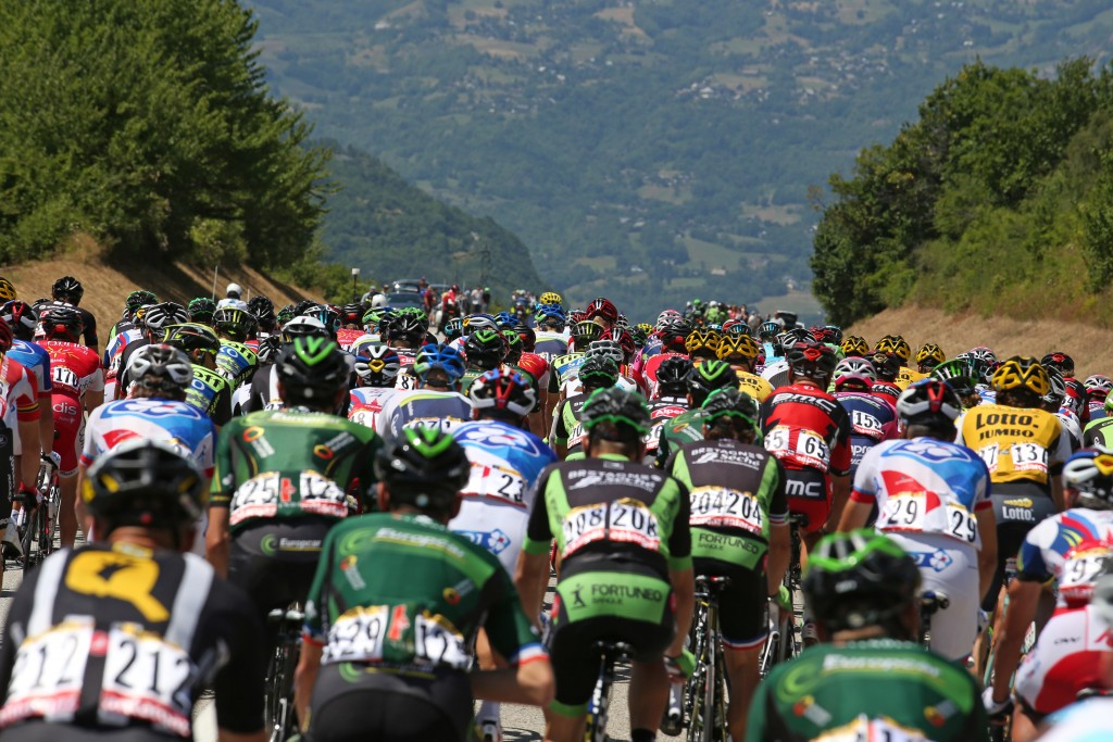 Riders cycle during the 110.5-km (68.6 miles) 20th stage of the Tour de France cycling race from Modane to Alpe d'Huez in the French Alps mountains, France on July 25, 2015. Photo by Stefano Rellandini/Reuters