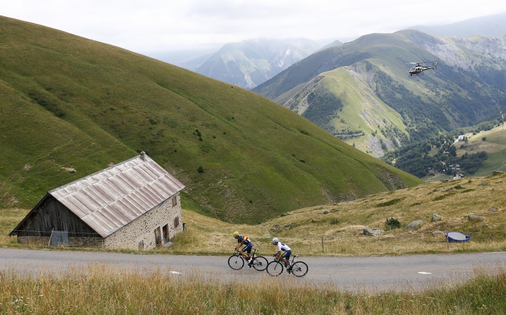 Movistar rider Nairo Quintana of Colombia (R) and his team mate Alejandro Valverde of Spain climb during the 110.5-km (68.6 miles) 20th stage of the 102nd Tour de France cycling race from Modane to Alpe d'Huez in the French Alps mountains, France on July 25, 2015. Quintana proved himself as he shaved off almost a minute and a half of Froome's lead in this crucial 20th stage. Photo by Stefano Rellandini/Reuters
