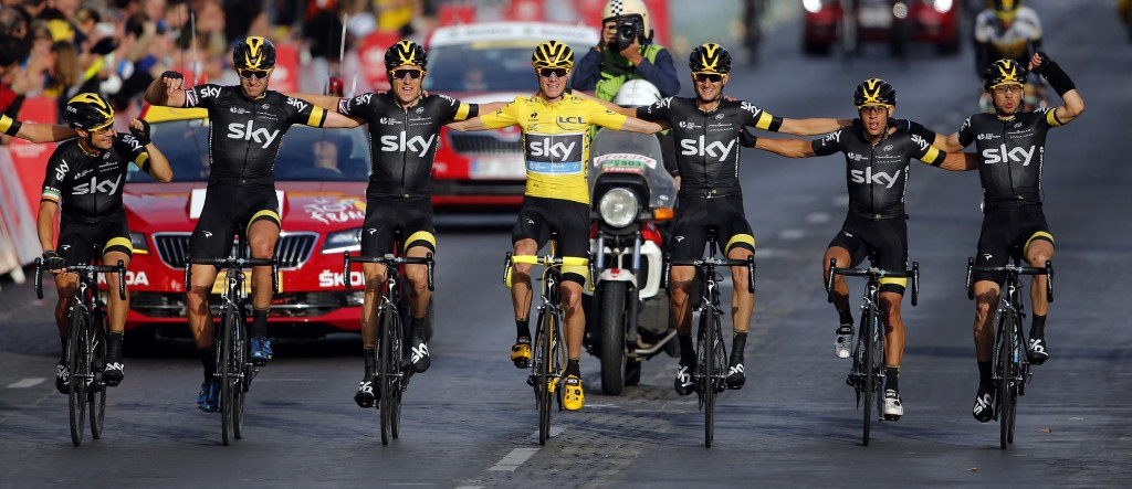 Team Sky rider Chris Froome of Britain (C), the race leader's yellow jersey, celebrates his overall victory with team-mates after the 109.5-km (68 miles) final 21st stage of the 102nd Tour de France cycling race from Sevres to Paris Champs-Elysees, France, July 26, 2015. Photo by Stephane Mahe/Reuters