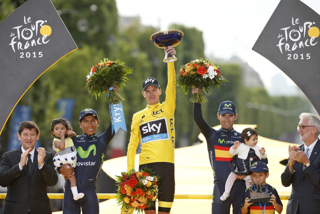 Team Sky rider Chris Froome of Britain (C), the race leader's yellow jersey, celebrates his overall victory on the podium with second placed Movistar rider Nairo Quintana of Colombia (L) and third placed Movistar rider Alejandro Valverde of Spain (R) after the 109.5-km (68 miles) final 21st stage of the 102nd Tour de France cycling race from Sevres to Paris Champs-Elysees, France on July 26, 2015. Quintana faced a set back getting caught in an accident early on, his performance in the 20th stage anticipates that he will be a major star in future races. Photo by Benoit Tessier/Reuters