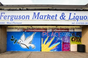 Ferguson paintings on boarded-up windows