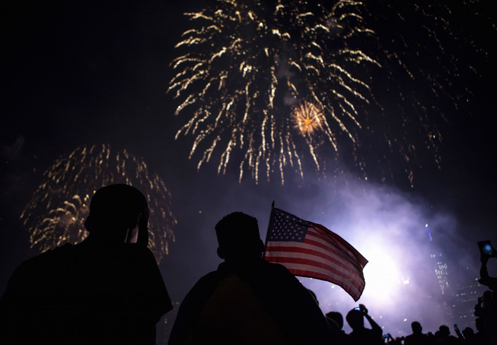 Spectators watch the Macy's Fourth of July fireworks explode over the East River in New York, July 4, 2014. New studies sh...