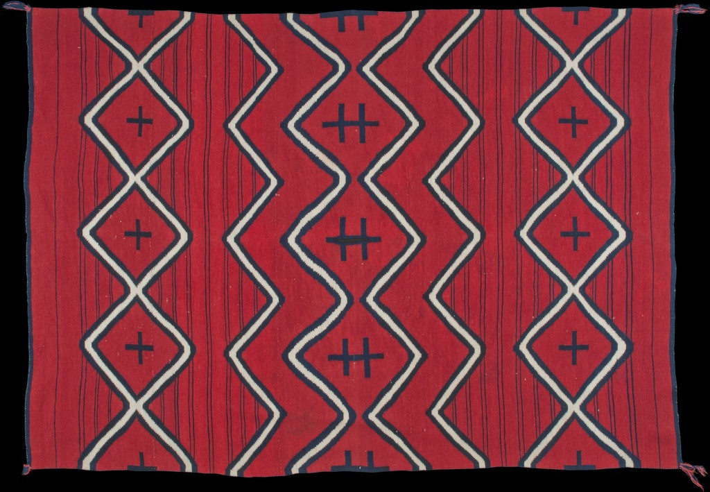 Navajo sarape with small poncho neck slit, Navajo Nation, Arizona or New Mexico, mid-Classic period, ca. 1865. Red raveled wool weft yarn (one–two S-spun strands) dyed with 100 percent cochineal, 72 x 48 in.; slit length 4¨þ in. Courtesy of The Owings Gallery, Santa Fe, New Mexico.