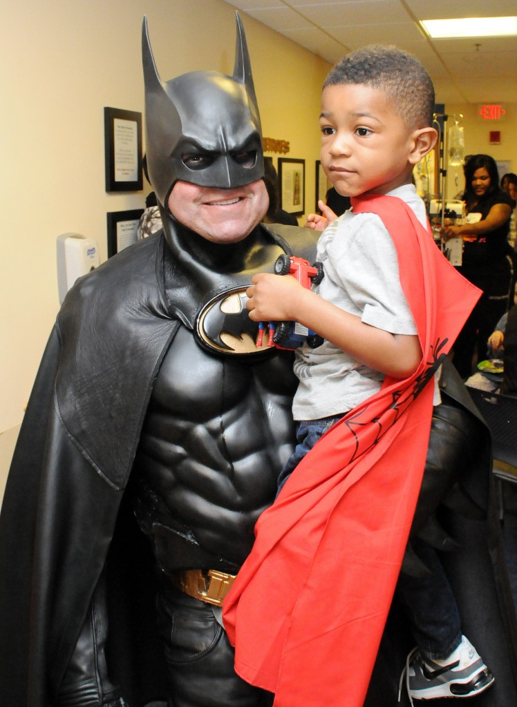 Lenny Robinson with a patient at the annual Hope for Henry Superhero Celebration for kids at Children's National Medical Center (Children's Hospital) in Washington, D.C. Photo courtesy of Hope for Henry