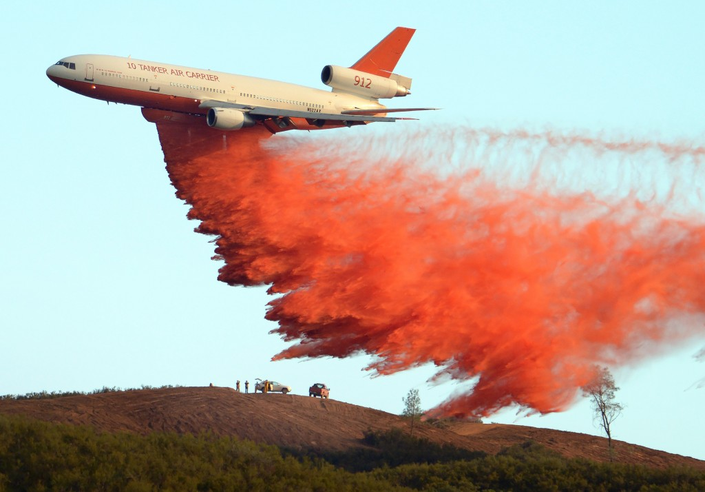 An air tanker drops fire retardant along a ridge to help contain the Rocky fire near Clearlake, California on August 2, 2015. Photo by Josh Edelson/AFP/Getty Images