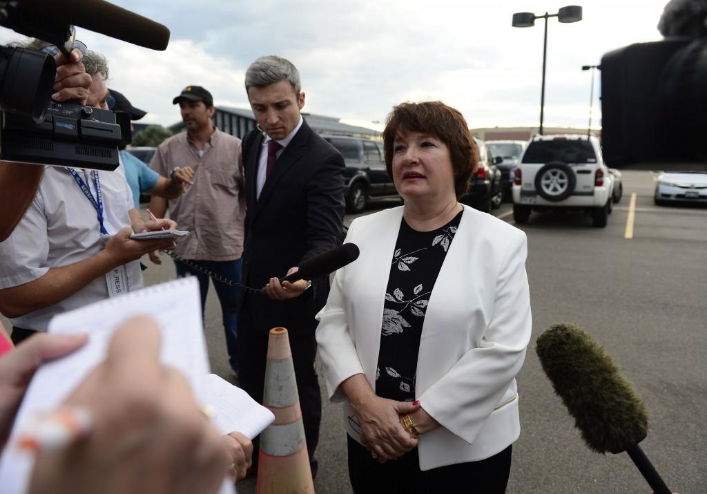 "One juror, who only wanted to be identified as ""juror 17"", talks with the media in the parking lot of the courthouse after the conclusion of the trial. Photo by Kathryn Scott Osler/The Denver Post via Getty Images."