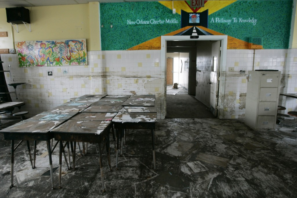 Mud residue is visible in a hurricane-damaged cafeteria at New Orleans Charter Middle School, seen on Feb. 21, 2006. Did Hurricane Katrina give New Orleans' chronically underperforming school system a fresh start? Photo by Lee Celano/Reuters