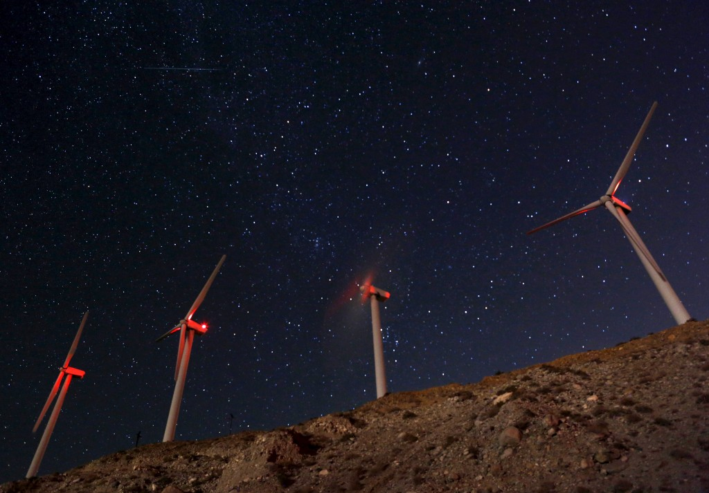 A meteor (top L) speeds past windmills at the San Gregornio Pass Wind Farm near Whitewater, California, August 13, 2015. Photo by Sam Mircovich/Reuters