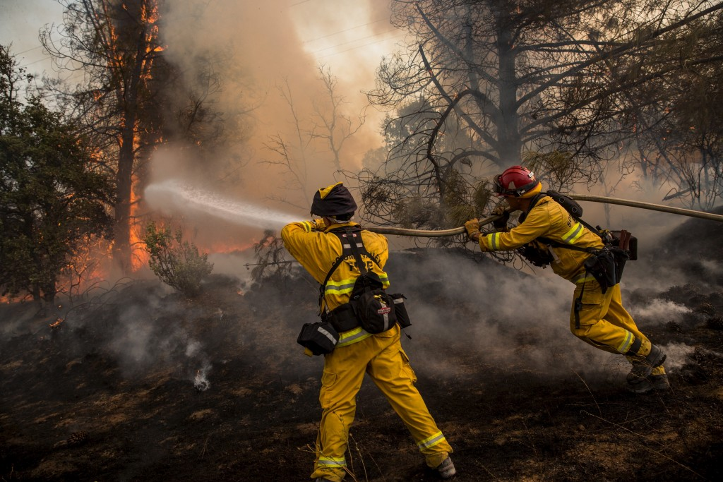 Firefighters race to battle a spot fire at the Rocky Fire in Lake County, California July 30, 2015. Photo by Max Whittaker/Reuters