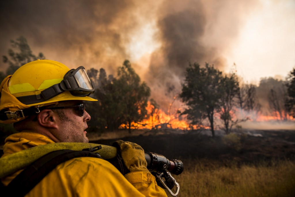 A firefighter watches for spot fires at the Rocky Fire in Lake County, California July 30, 2015. Photo by Max Whittaker/Reuters