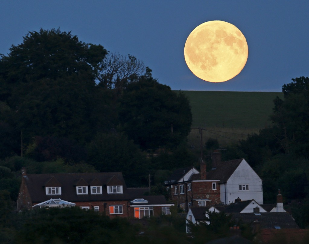 The Blue Moon is seen over Loosely Row, near Princes Risborough, southeast England, July 31, 2015. Photo by Eddie Keogh/Reuters.