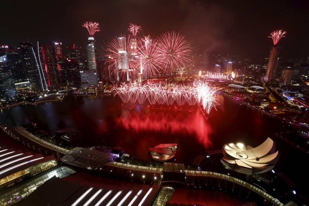 Fireworks explode over Marina Bay during Singapore's Golden Jubilee celebrations, in Singapore August 9, 2015. Photo by Tan Shung Sin/Reuters.