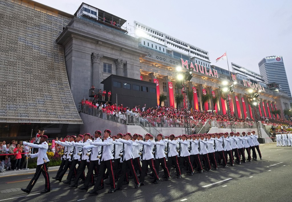 The Singapore Armed Forces 1st Commando Battalion guard of honour marches past during Singapore's Golden Jubilee celebration Parade. Photo by Kevin Lam/Reuters.