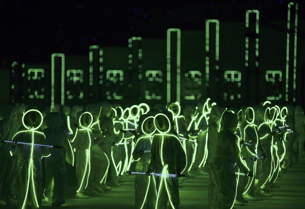 Children wearing LED-lit costumes perform during Singapore's Golden Jubilee celebration parade. Photo by Kevin Lam/Reuters.