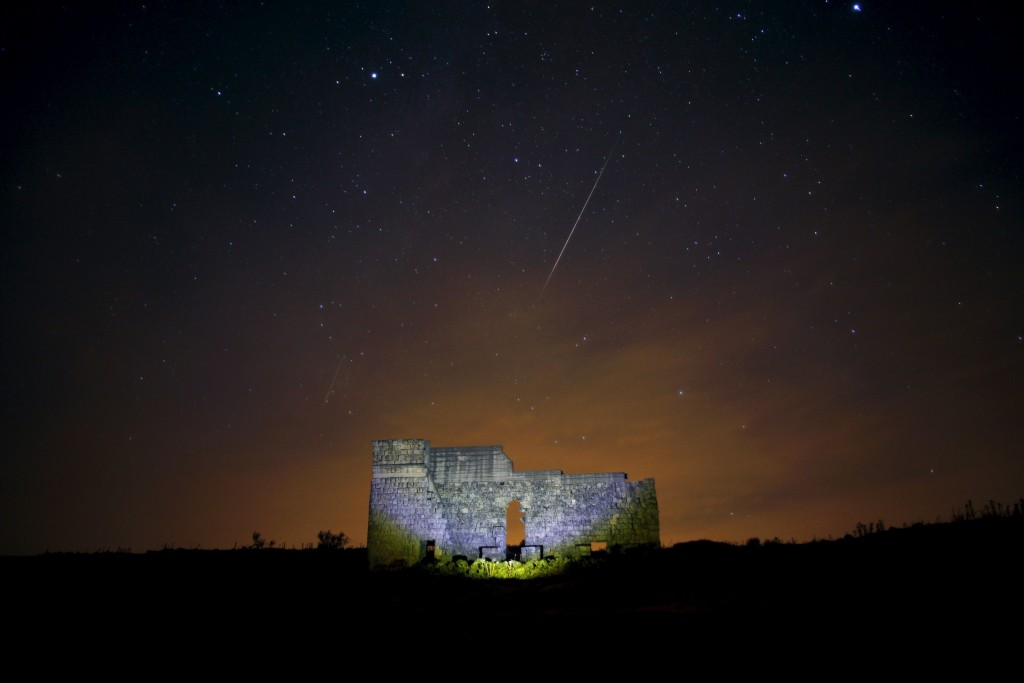 Meteors streak across the sky over a Roman theatre in the ruins of Acinipo, during the Perseid meteor shower near Ronda, southern Spain, in the early morning of August 13, 2015. Photo by Jon Nazca/Reuters