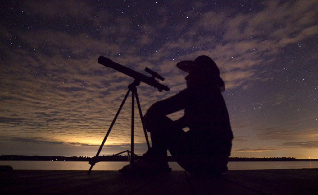 A stargazer waits for light clouds to clear to watch the Perseid meteor shower to begin near Bobcaygeon, Ontario, August 12, 2015. Photo by Fred Thornhill/Reuters