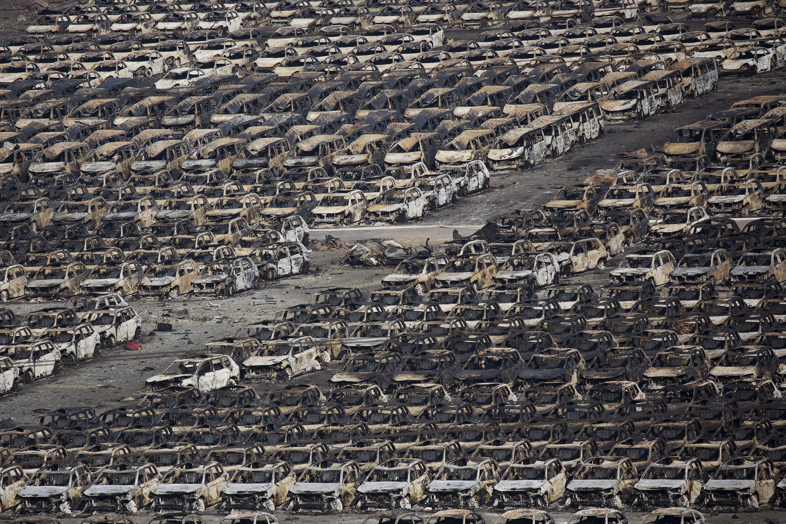 Burnt cars are seen near the site of the explosions, August 13, 2015. Photo by Damir Sagolj/Reuters