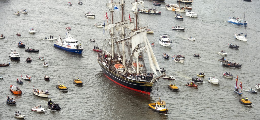 The Stad Amsterdam  clipper, cetner, sails during the Sail-In Parade on August 19, 2015. Photo by Toussaint Kluiters/Reuters