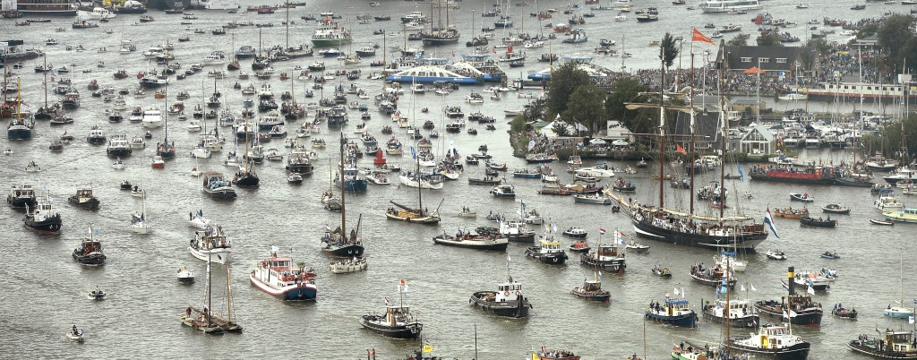 Tall ships mark the beginning of the Sail Amsterdam 2015 nautical festival on August 19, 2015. Photo by Toussaint Kluiters/Reuters