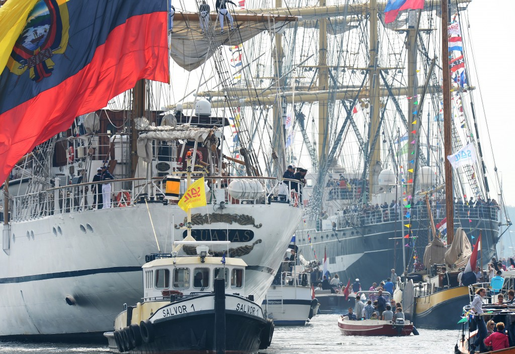Ecuador's tall ship Guayas is on the left at the Sail-In Parade in Amsterdam, Netherlands. Photo by Paul Vreeker
