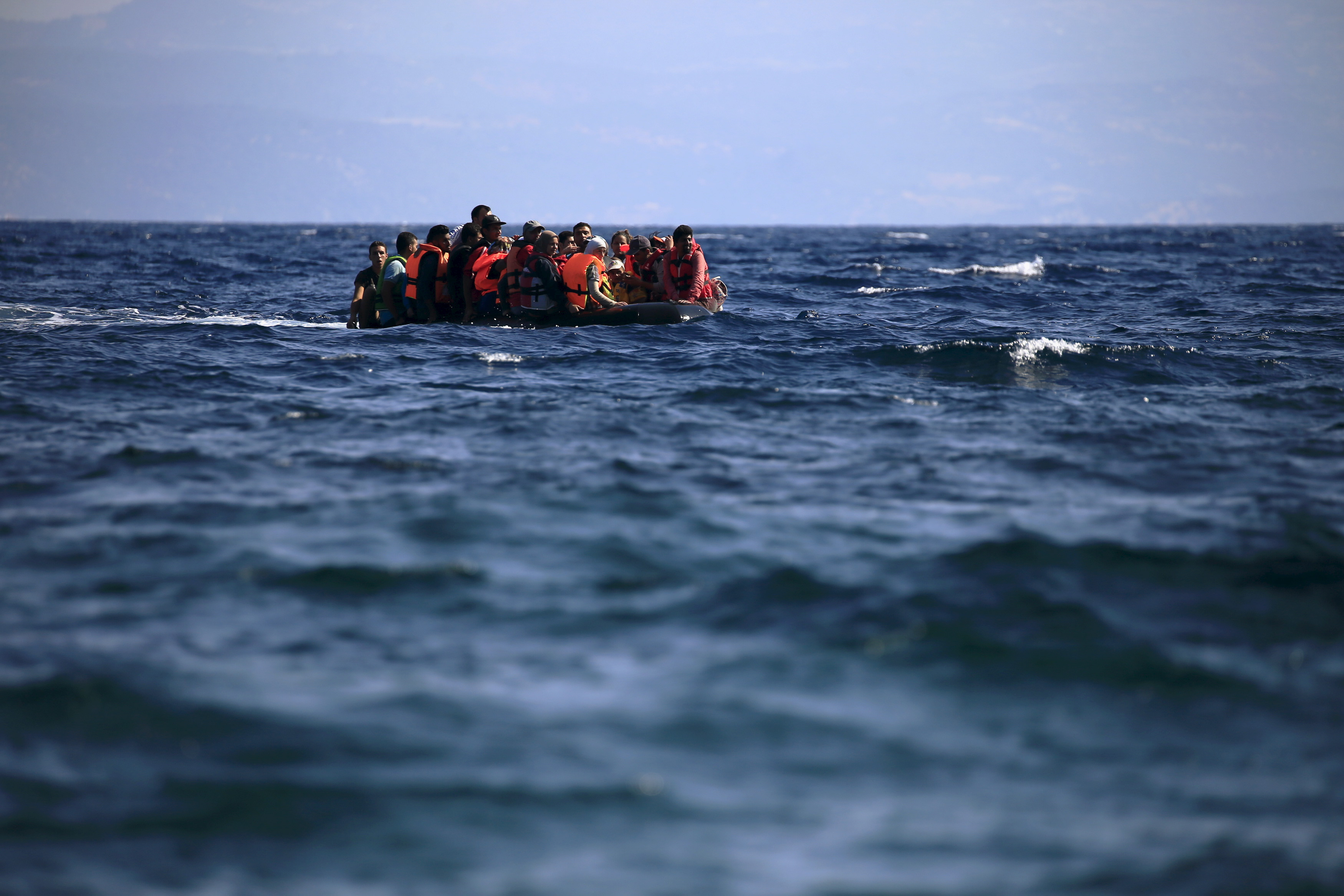 Syrian refugees on a dinghy approach, in rough seas, a beach on the island of Lesbos, Greece August 23, 2015. Photo by Alkis Konstantinidis/Reuters.