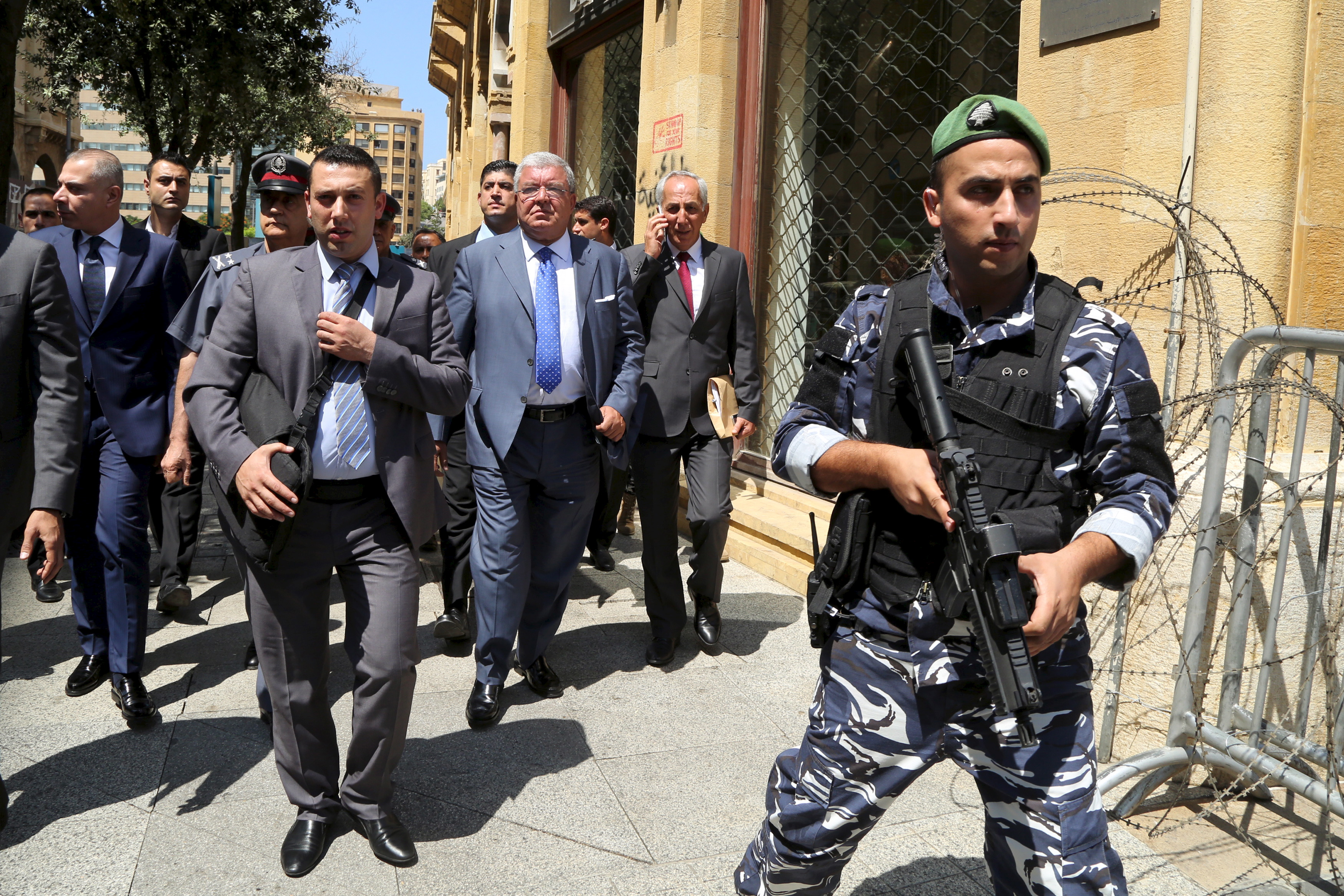 Lebanese Interior Minister Nouhad Machnouk (center) tours the streets of Beirut on Aug. 24, a day after protests against the government turned into violent clashes with police. Photo by Aziz Taher/Reuters
