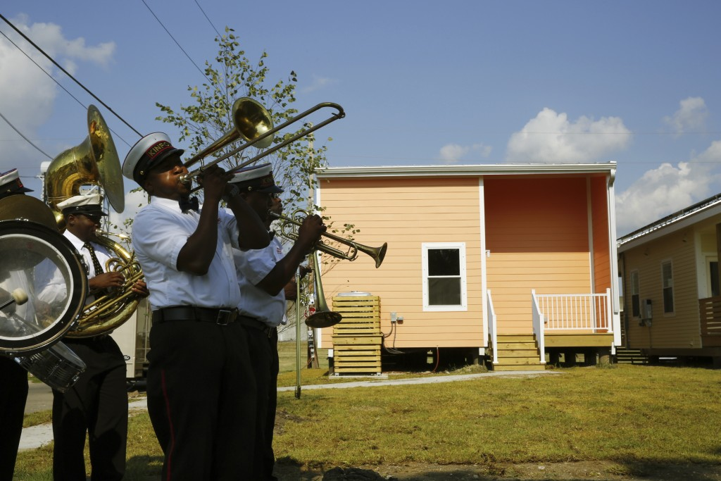The Kinfolk Brass Band performs at a Make It Right Foundation function marking the tenth anniversary of Hurricane Katrina in the Lower 9th Ward in New Orleans, Louisiana August 29, 2015.  REUTERS/Edmund D. Fountain - RTX1Q6P5