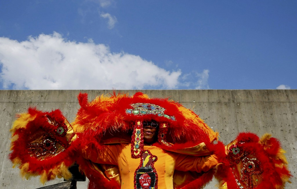 Mary Kay, second queen of the Wild Tchoupitoulas Mardi Gras Indian Tribe, raises her arms along the Industrial Canal levee in the Lower 9th Ward at a ceremony marking the 10th Anniversary of Hurricane Katrina, in New Orleans, Louisiana, August 29, 2015.  REUTERS/Edmund D. Fountain - RTX1Q7PM