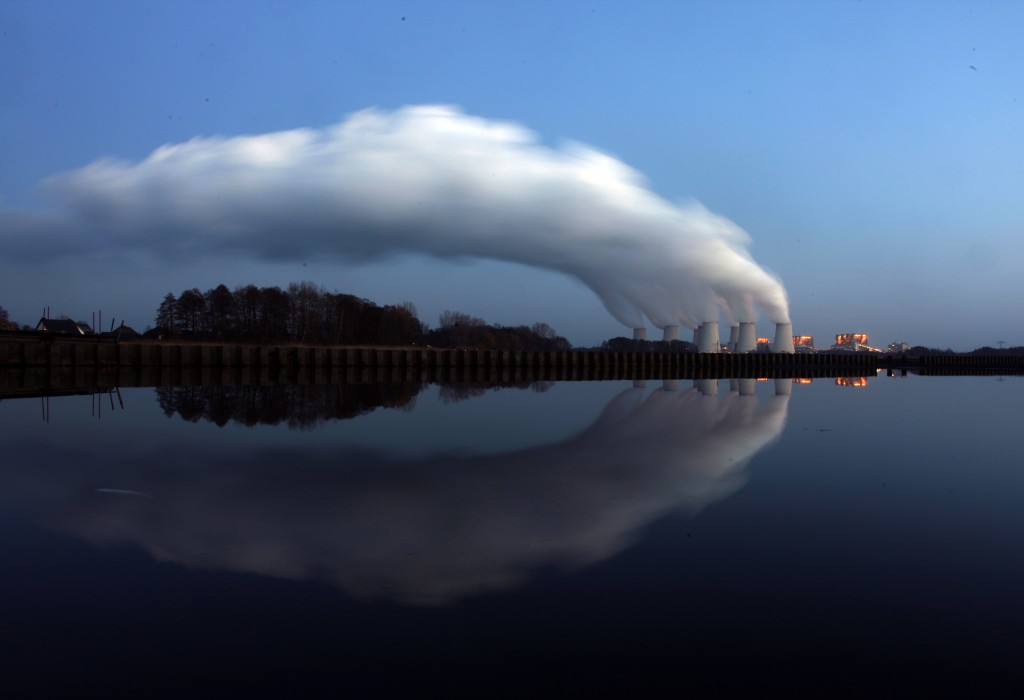 Steam billows from the cooling towers of a coal power station in ea…