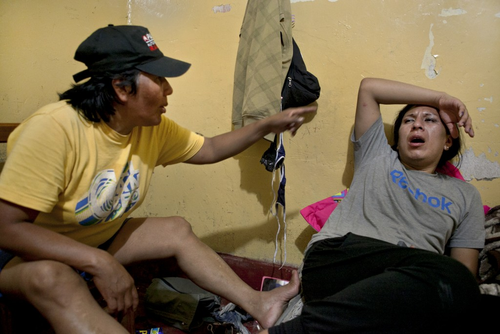 After many hours of drinking, Tamara, right, and her mother Evila, left, argue about her work on the streets.