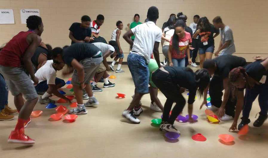 "KaBOOM! trained 38 youth ""play associates"" in Baltimore to help run activity stations around the city in August 2015. Photo courtesy of KaBOOM!"