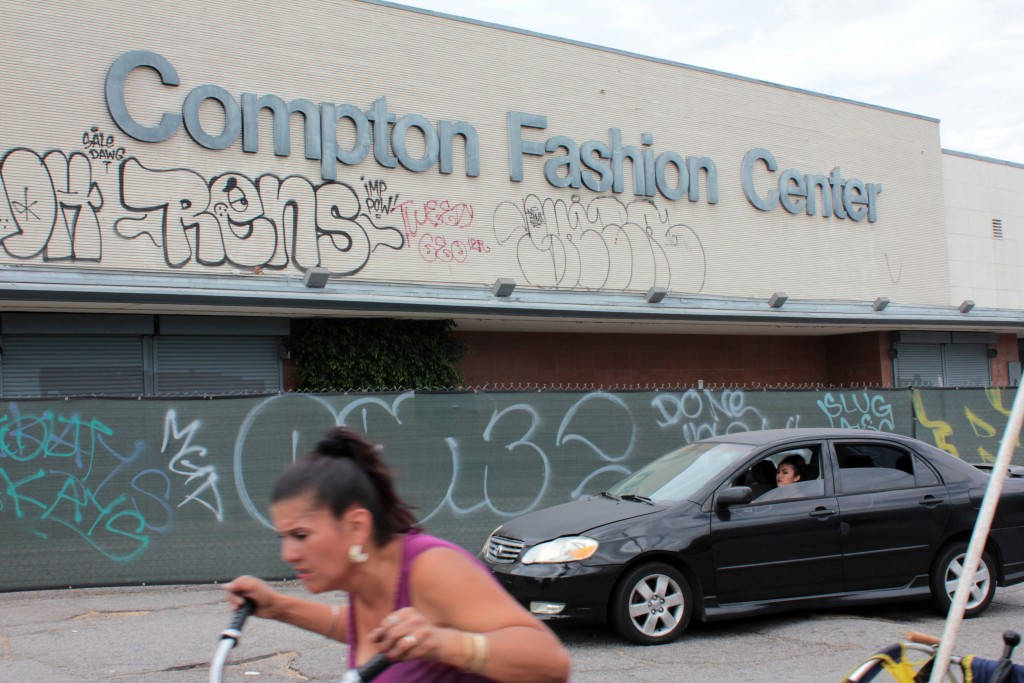 "The Compton Swap Meet, also known as the Compton Fashion Center, closed its doors in January to make way for a rumored Wal-Mart. The site was vital to the burgeoning gangsta rap scene where local shops, such as the Cycadelic Music Corner, supported albums like ""Straight Outta Compton"" when other retailers and radio stations turned away. Photo by Joshua Barajas/PBS NewsHour"