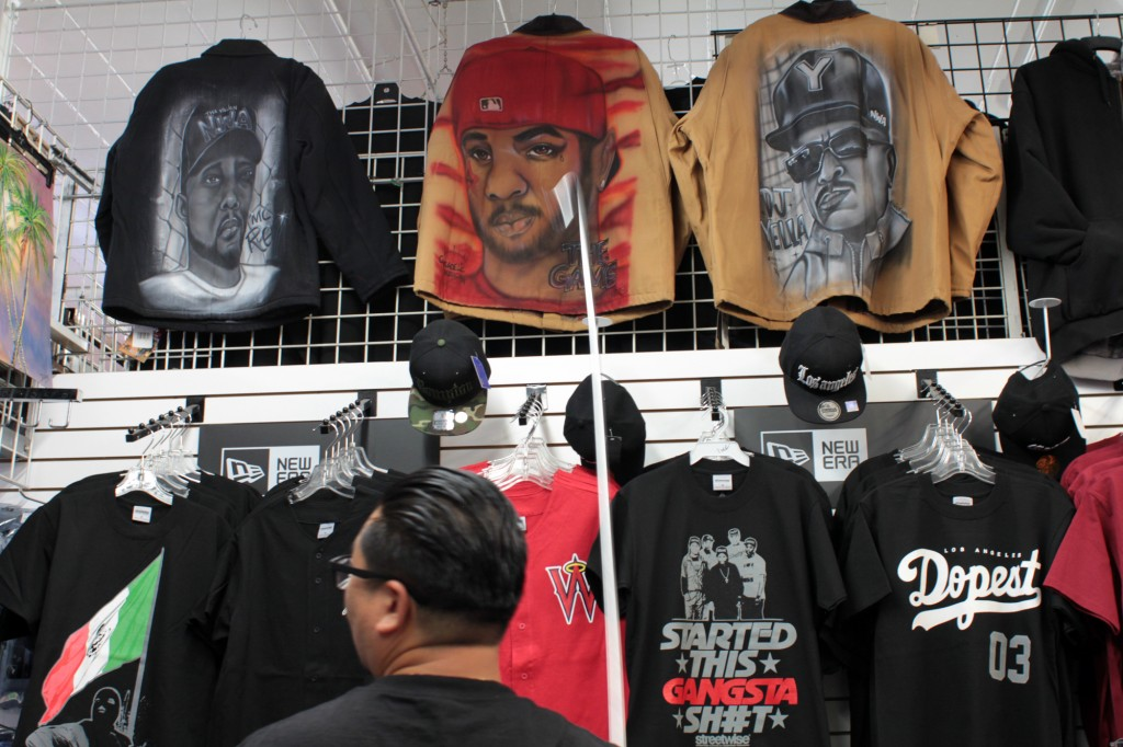 Some of Compton's finest such as rapper The Game and N.W.A. founding members MC Ren and DJ Yella adorn jackets at the Cycadelic Music Corner in Compton. Photo by Joshua Barajas/PBS NewsHour