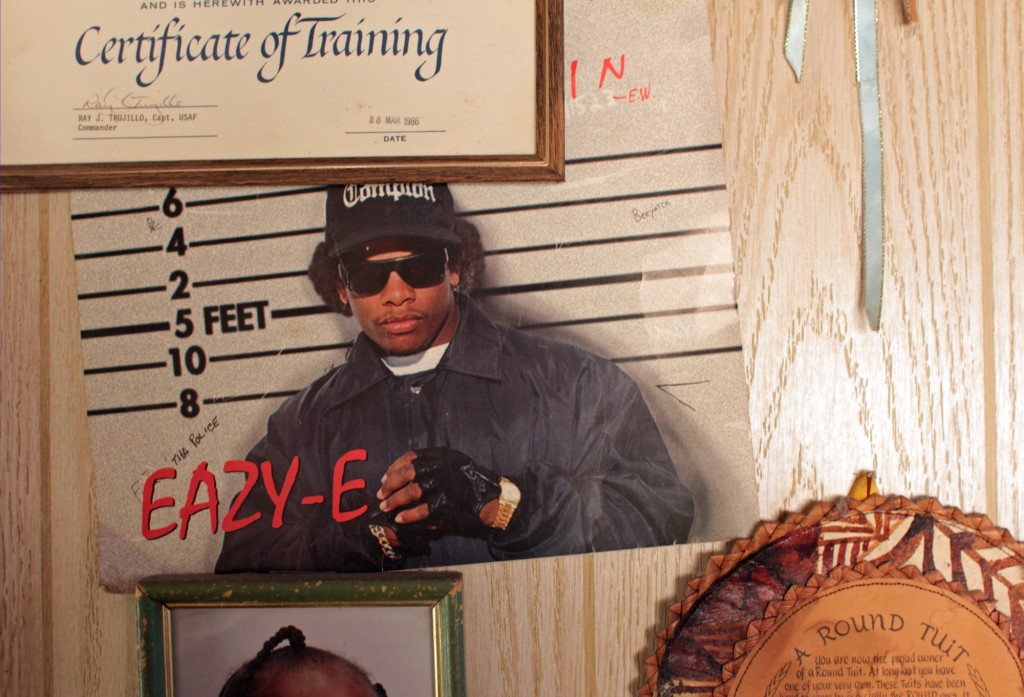 "Plenty of Eazy-E memorabilia appear throughout the rapper's childhood home in Compton. The late rapper's son other family members continue to live there. ""I'm not scared of my city,"" Wright Jr. told the NewsHour. ""If you can adapt to this life, always flooring, always staying on your toes, it prepares you for life."" Photo by Joshua Barajas/PBS NewsHour"