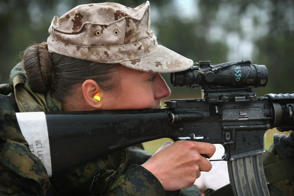 PARRIS ISLAND, SC - FEBRUARY 25: Marine recruit Cora Ann Lacher from Manuet, NY fires on the rifle range during boot camp February 25, 2013 at MCRD Parris Island, South Carolina. All female enlisted Marines and male Marines who were living east of the Mississippi River when they were recruited attend boot camp at Parris Island. About six percent of enlisted Marines are female. (Photo by Scott Olson/Getty Images)