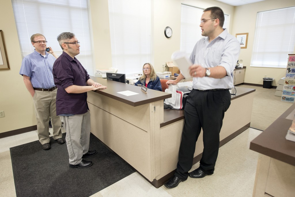 Rowan County Deputy Clerk Nathan Davis, right, informs David Moore, center, and David Ermold, left, that he won't issue them a marriage license on Aug. 13, 2015, at the Rowan County Clerk's office in Morehead, Kentucky. The couple tried for a fourth time Tuesday and were denied again. John Flavell/Lexington Herald-Leader/TNS via Getty Images