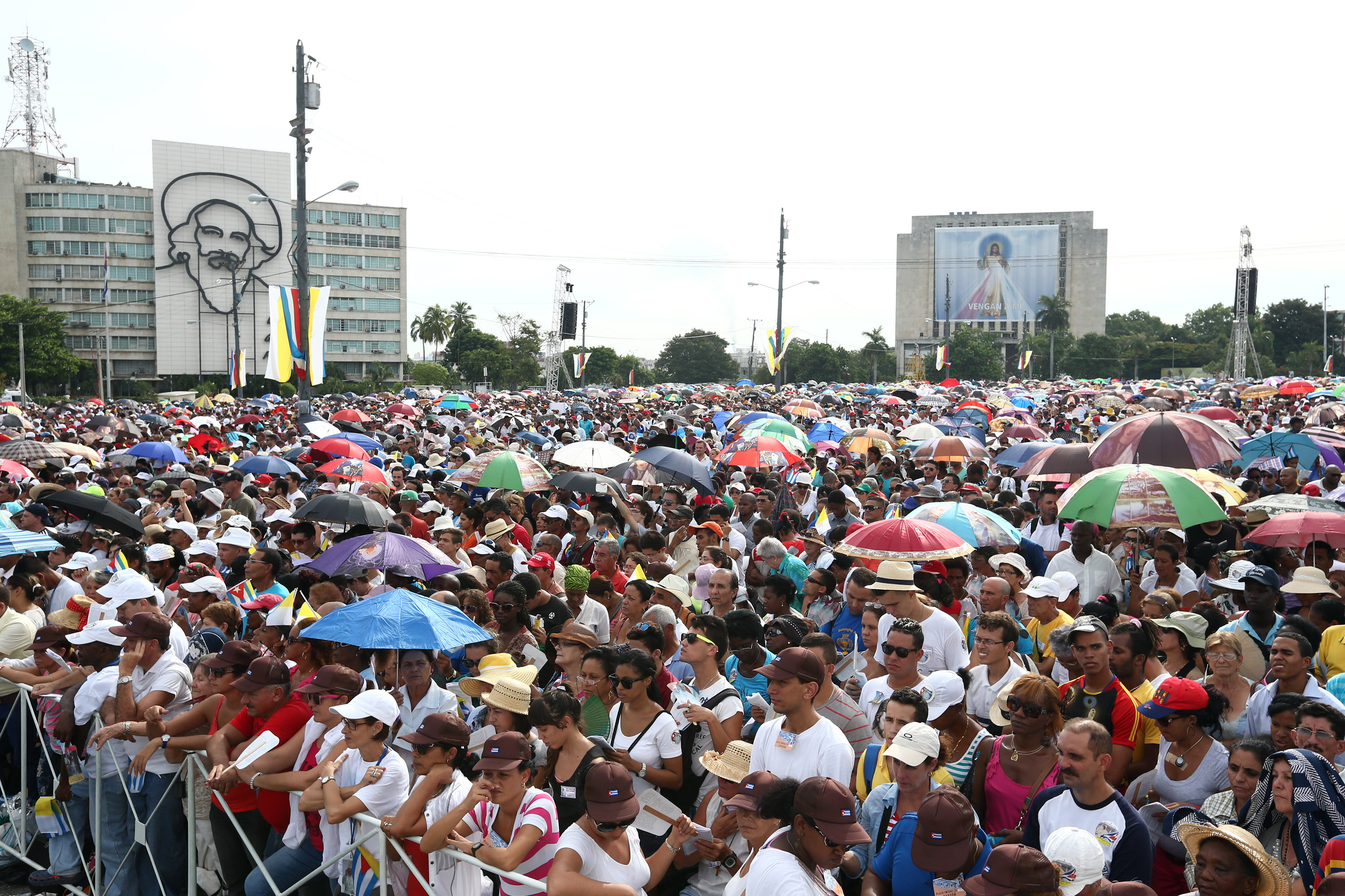 HAVANA, CUBA - SEPTEMBER 20:  People look on as Pope Francis performs Mass on September 20, 2015 in Revolution Square in Havana, Cuba. Pope Francis is on the first full day of his three day visit to Cuba where he will meet President Raul Castro and hold Mass in Revolution Square before travelling to Holguin, Santiago de Cuba and El Cobre then onwards to the United States.  (Photo by Carl Court/Getty Images)