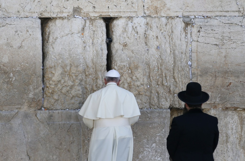 Pope Francis prays as a Jewish rabbi looks on at the Western Wall in Jerusalem's Old City on May 26, 2014. Photo by Thomas Coex/AFP/Getty Images)