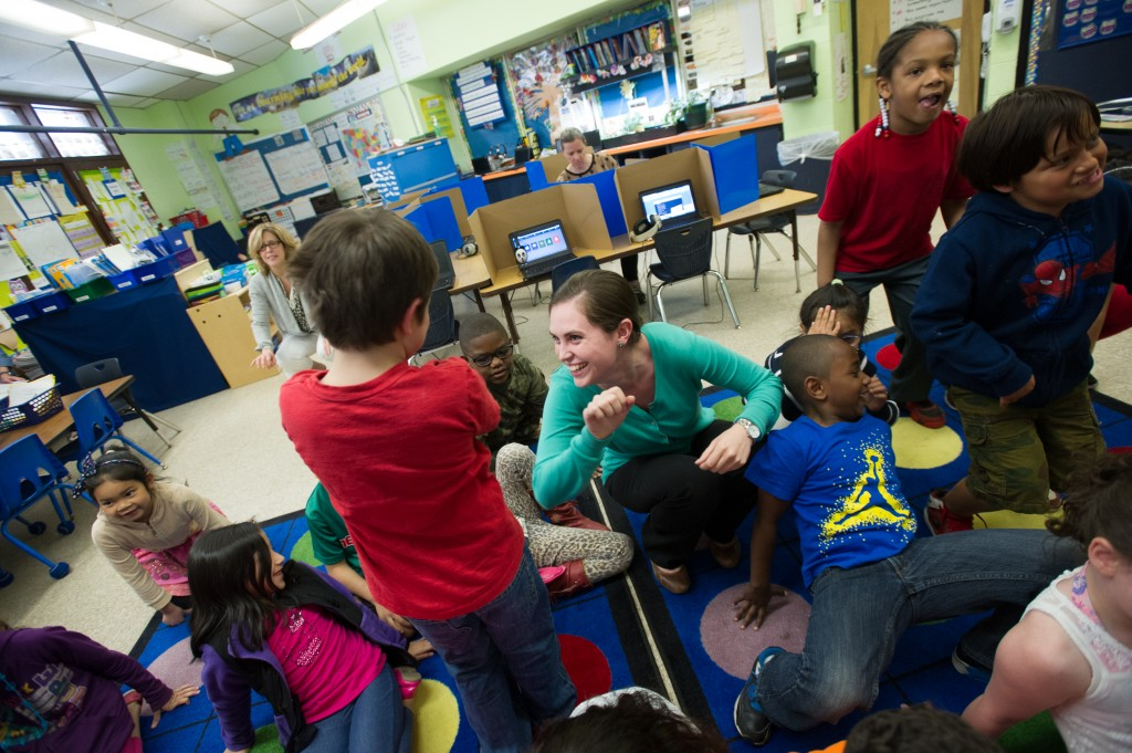 Pleasant View Elementary School teacher Alex Gibbons, center, dances with her students  during a transition between lessons in her class this past May. Photo by Gretchen Ertl/Hechinger Report