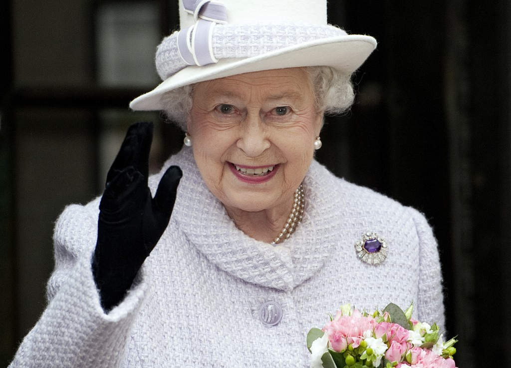 Britain's Queen Elizabeth waves during a visit to the Bank of England in the City of London Dec. 13, 2012. Photo by Eddie Mulholland/Reuters