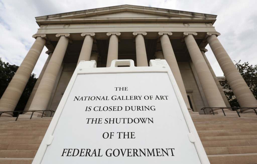 A sign to inform the visitors that the National Gallery of Art is closed in Washington, D.C. during the government shutdown in 2013. Photo by Kevin Lamarque/Reuters