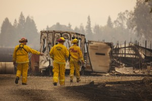 Firefighters survey a destroyed home at the so-called Valley Fire near Middleton, California September 14, 2015. A Northern California wildfire ranked as the most destructive to hit the drought-stricken U.S. West this year has claimed one life and burned at least 400 homes to the ground, fire officials reported on Monday, saying they expected the property toll to climb. Photo by David Ryder/REUTERS